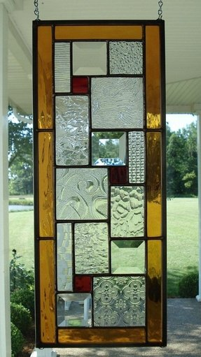 Stained glass window panel with ambers