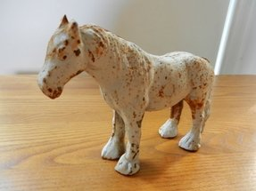 Vintage cast iron farm horse door stop