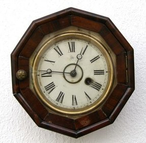 Old wooden wall clock