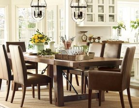 Dining table chairs and lanterns