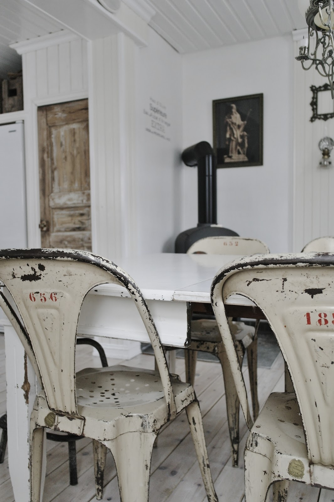 Charmant It Features Metal Chairs With A Distressed And Weathered Look And Original  Numbers On The Backrest. They Are Accompanied By A White, ...