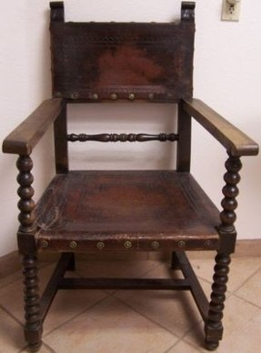 Antique spanish colonial hand tooled large leather carved arm chair