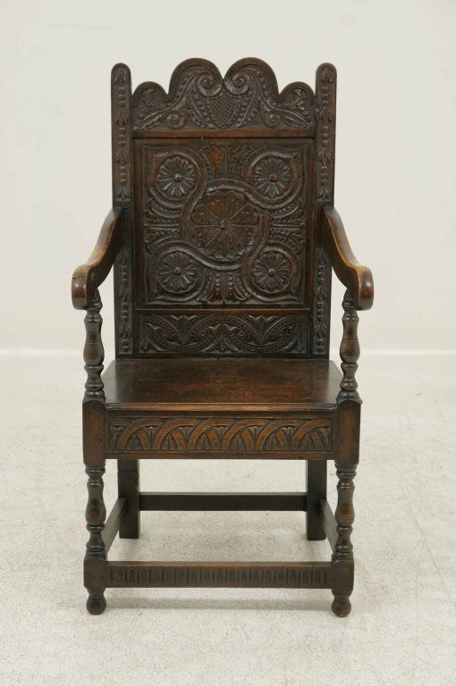 Antique chair with carved face