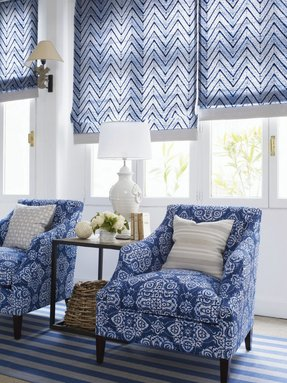 Beautiful roman shades in blue and white with coordinating chairs
