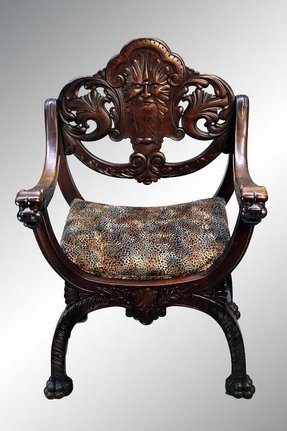 Carved mahogany arm chair