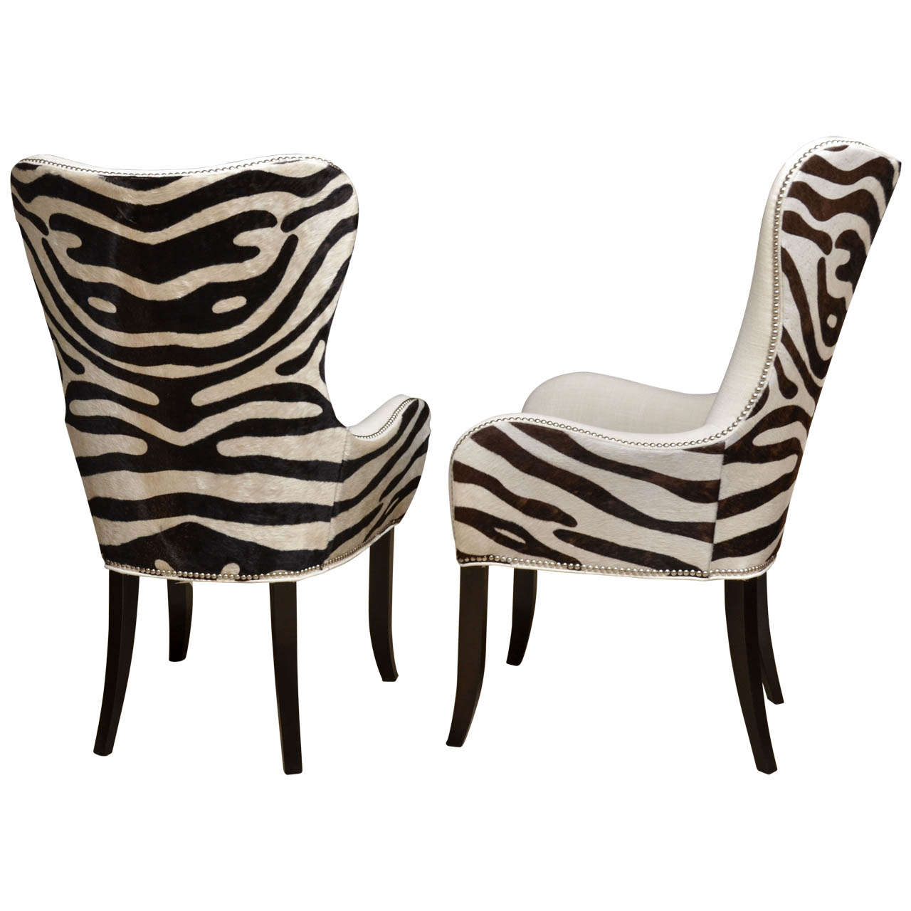 Pair of cowhide stenciled zebra arm chairs