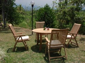 Teak round arm chairs 7
