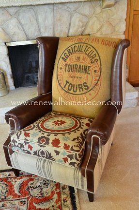 Vintage upholstered wing back chair 1