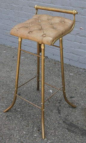 Set of eight french leather and brass bar stools from