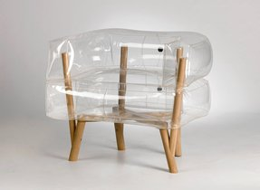 An inflatable chair with a wooden base that rethinks the