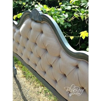 Tufted headboard with wood frame