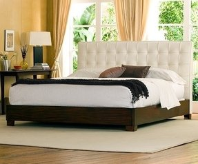 White tufted bed with crystals