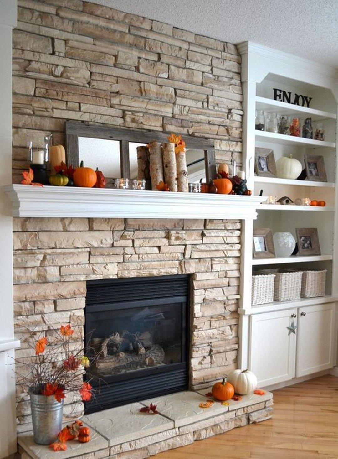 Stacked Stone Fireplace With Built Ins
