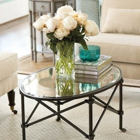 Oval mirrored coffee table