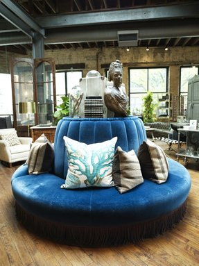 Retail store design eclectic a round blue banquette topped with