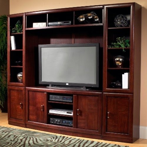 A Wooden TV Stand With An Entertainment Unit Around, Made Out Of Stylish  Cherry Wood With A Polished Finish. The Shelves And Compartments Around The  TV Make ...