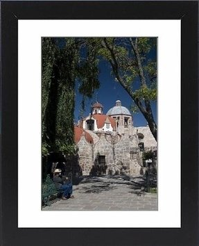 Framed Print of Local man resting on a park bench with Iglesia del Carmen in background
