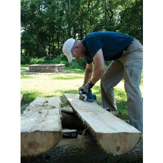 Making half log benches popular mechanics