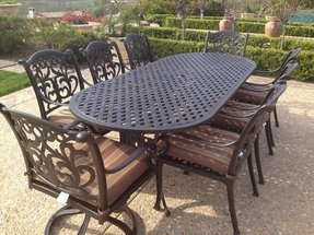 "Heritage Outdoor Living Flamingo Cast Aluminum 9pc Outdoor Patio Set with 42""x102"" Oval Table - Antique Bronze"