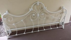 White wrought iron bed