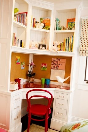 A Beautiful Contemporary Corner Desk For Kids With Tall Hutch Made Of White Finished Wooden Materials Has Heptagonal Red Top And Full