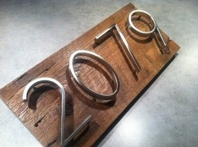 Modern metal house numbers mounted on