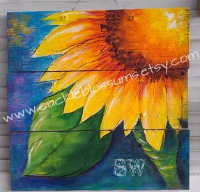 Colorful sunflower on rustic wood