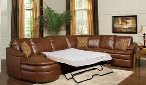 Leather sectional with sleeper and recliner