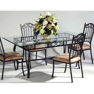 Wrought iron dining tables with glass tops
