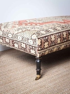 Coffee table with nesting ottomans 1