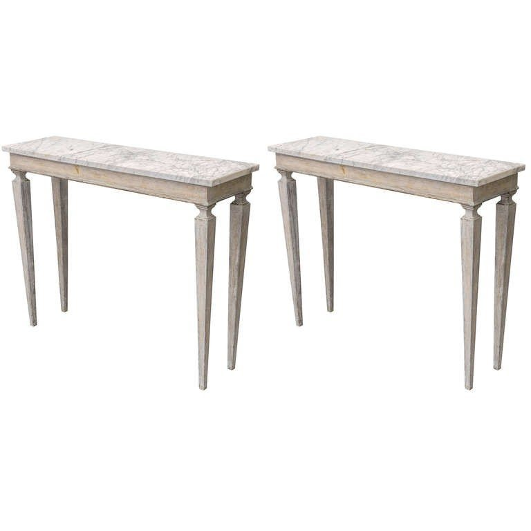 Pair of narrow painted console tables marble tops