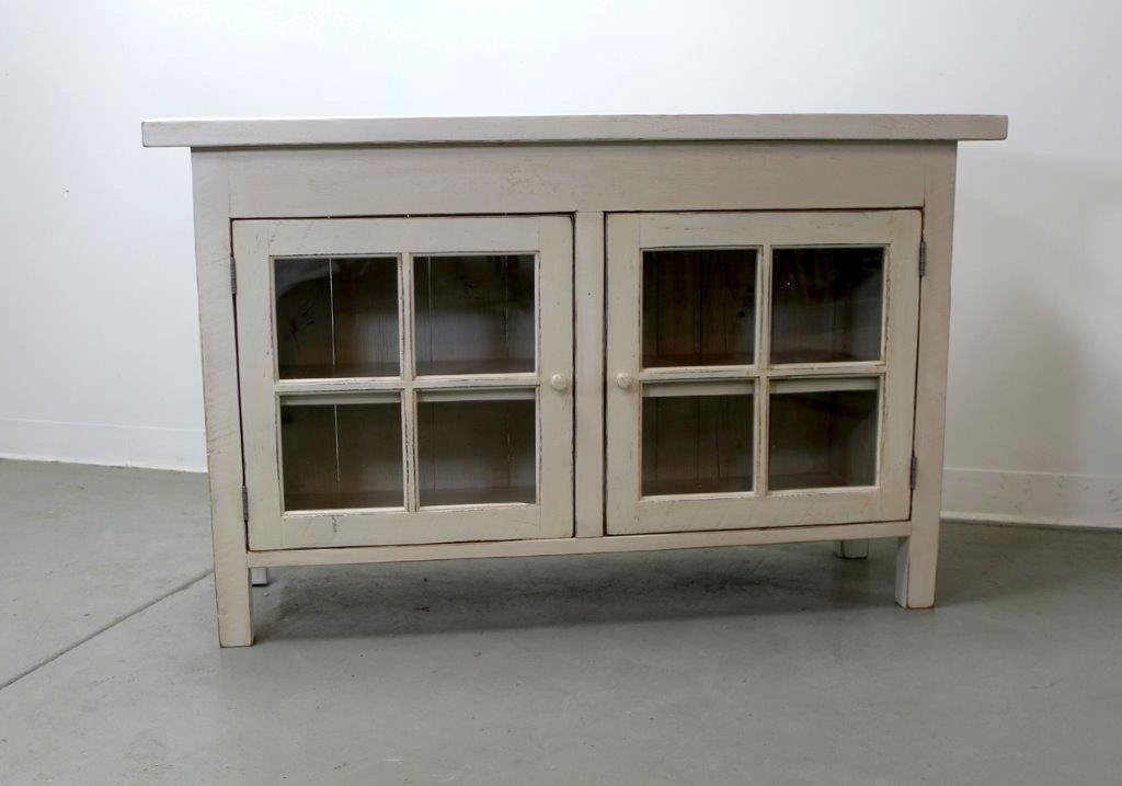 Small media cabinet with glass doors