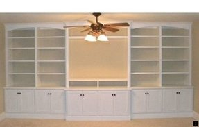 Built in entertainment center bookshelves eclectic family room philadelphia