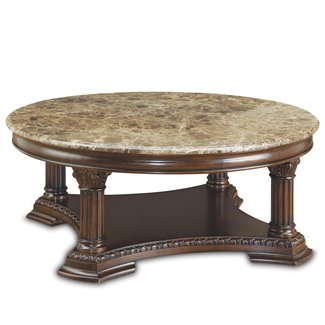 Classy wooden round coffee table design with gorgeous wood carving
