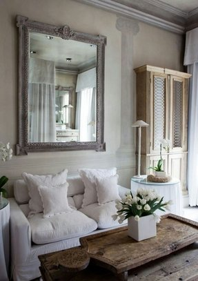 Love the grey wood mirror and the layering of the