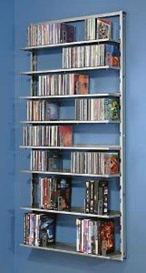 Genial Wall Mounted Rack For DVDs And CDs Of Different Type. This Solid Wooden  Construction Includes Many Shelves For These Items Or Books, Decorations  And Other ...