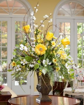Glass vase with artificial flowers