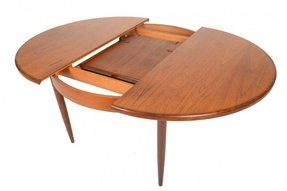 Round dining table with butterfly leaf