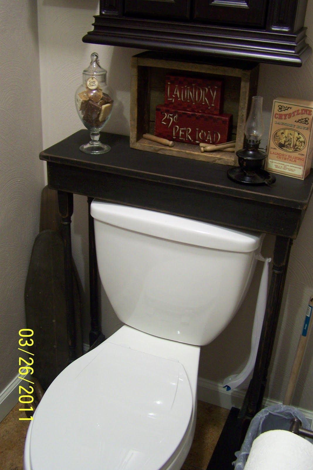 Superbe Toilet Tank Storage. A Small Table Placed Over ...
