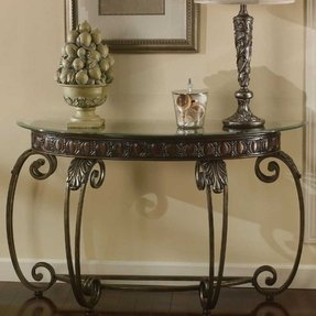 Metal sofa table with glass top