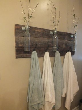 Reclaimed wooden towel rack w bottle
