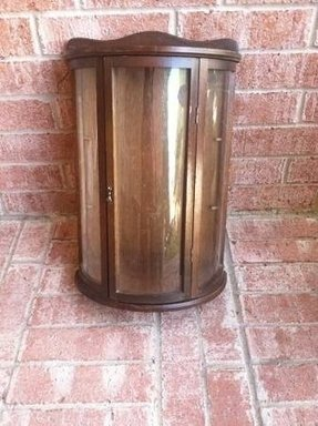 Small cabinet with glass doors