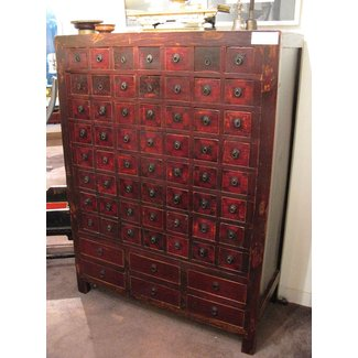 Cabinet with many small drawers