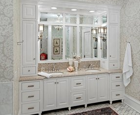 This Exquisite Elegant Bathroom Owes Its Chic To The Clic Wrap Around Mirrors Marble Countertops And White Linen Storage Cabinets With Ornate S