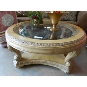 Blonde round ornate coffee table this is the finish on
