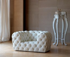 White tufted leather sofa by baxter 2