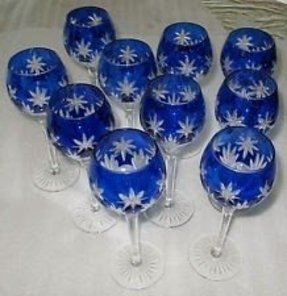 Crystal wine glass by horst belda cased in blue hand