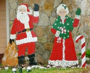 Outdoor santa claus figures