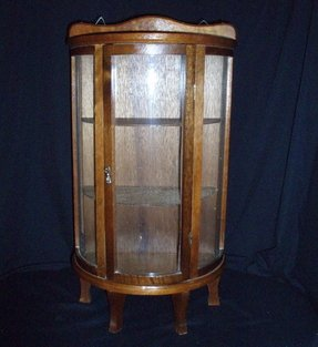 Antique glass curio cabinet