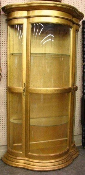 Gold finish curved glass curio cabinet